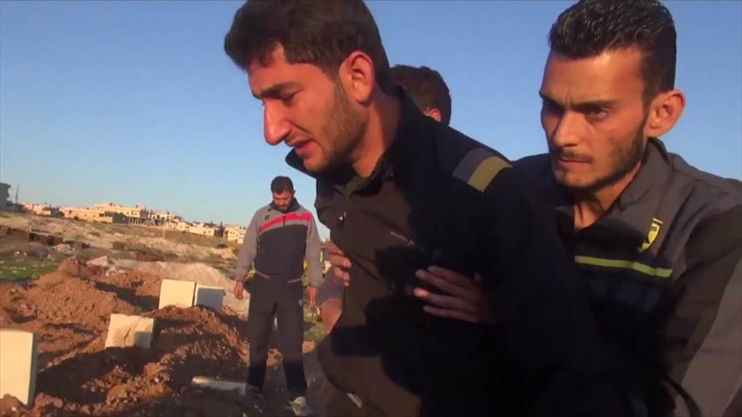 Grieving father in Syria