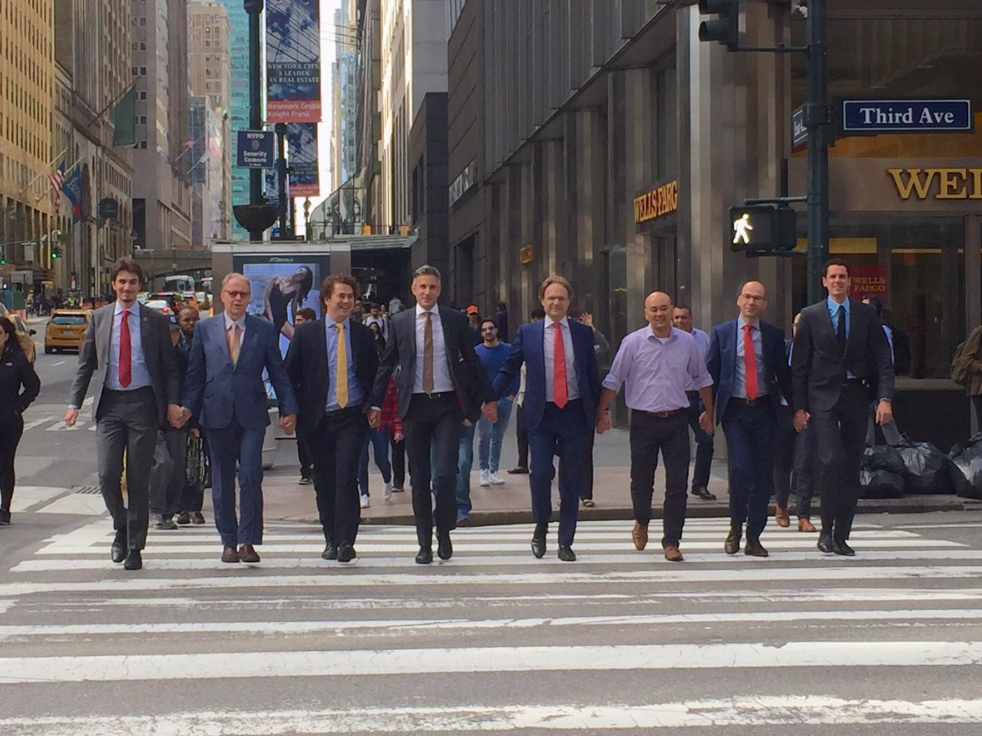 Dutch politicans cross a road in New York holding hands
